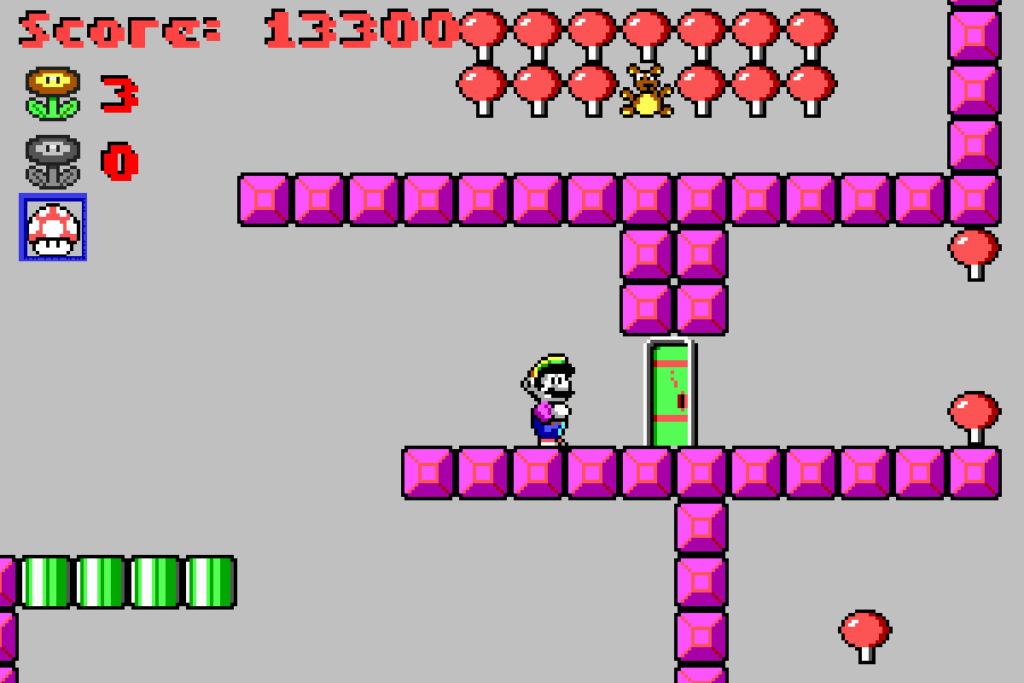 Mario is stopped by a green door which he needs to open via a keycard